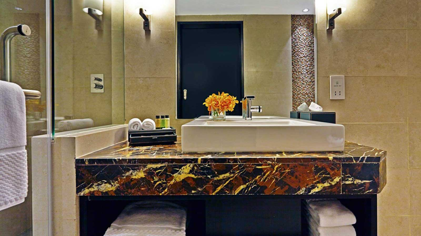 Bathroom in Deluxe Room at Amari Dhaka