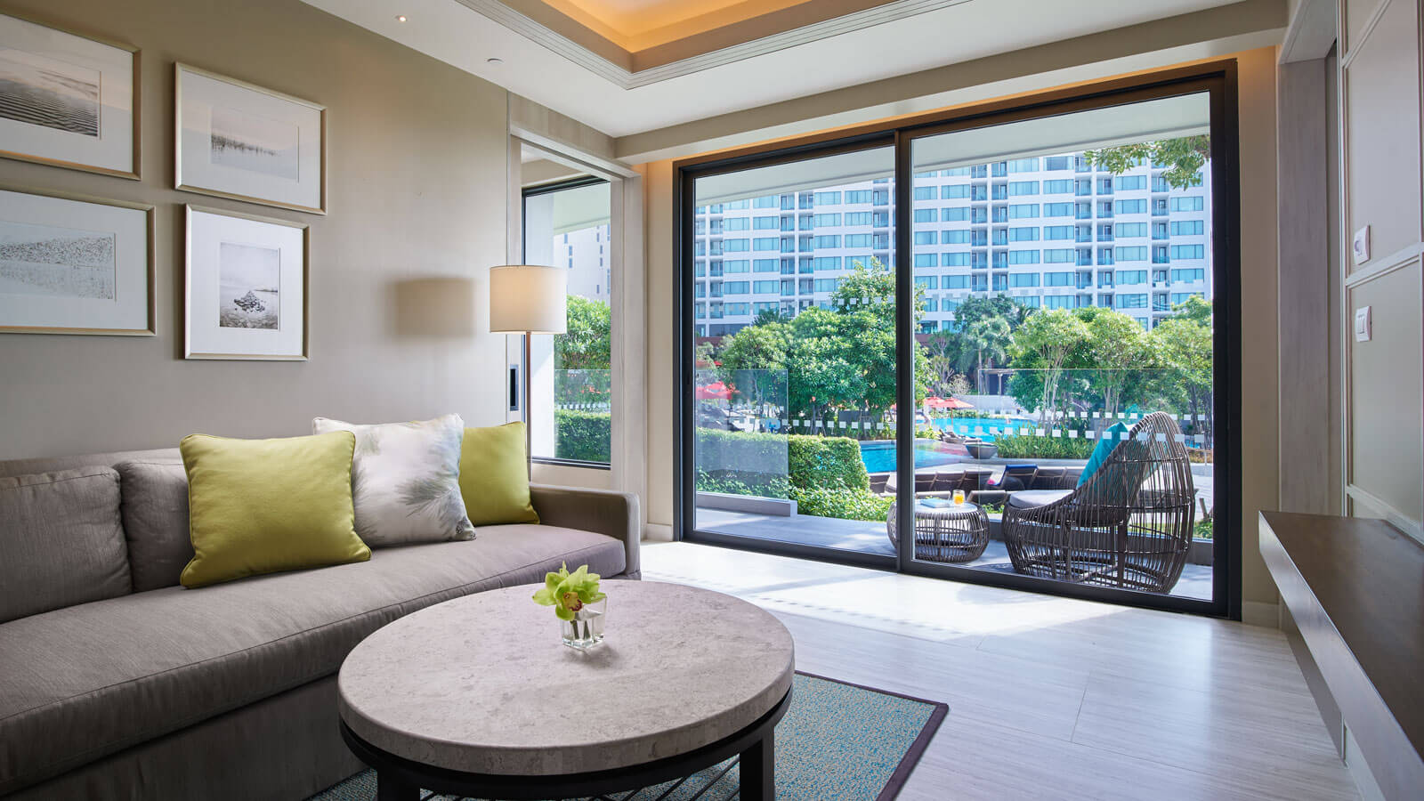 Living room with balcony in Two Bedroom Suite
