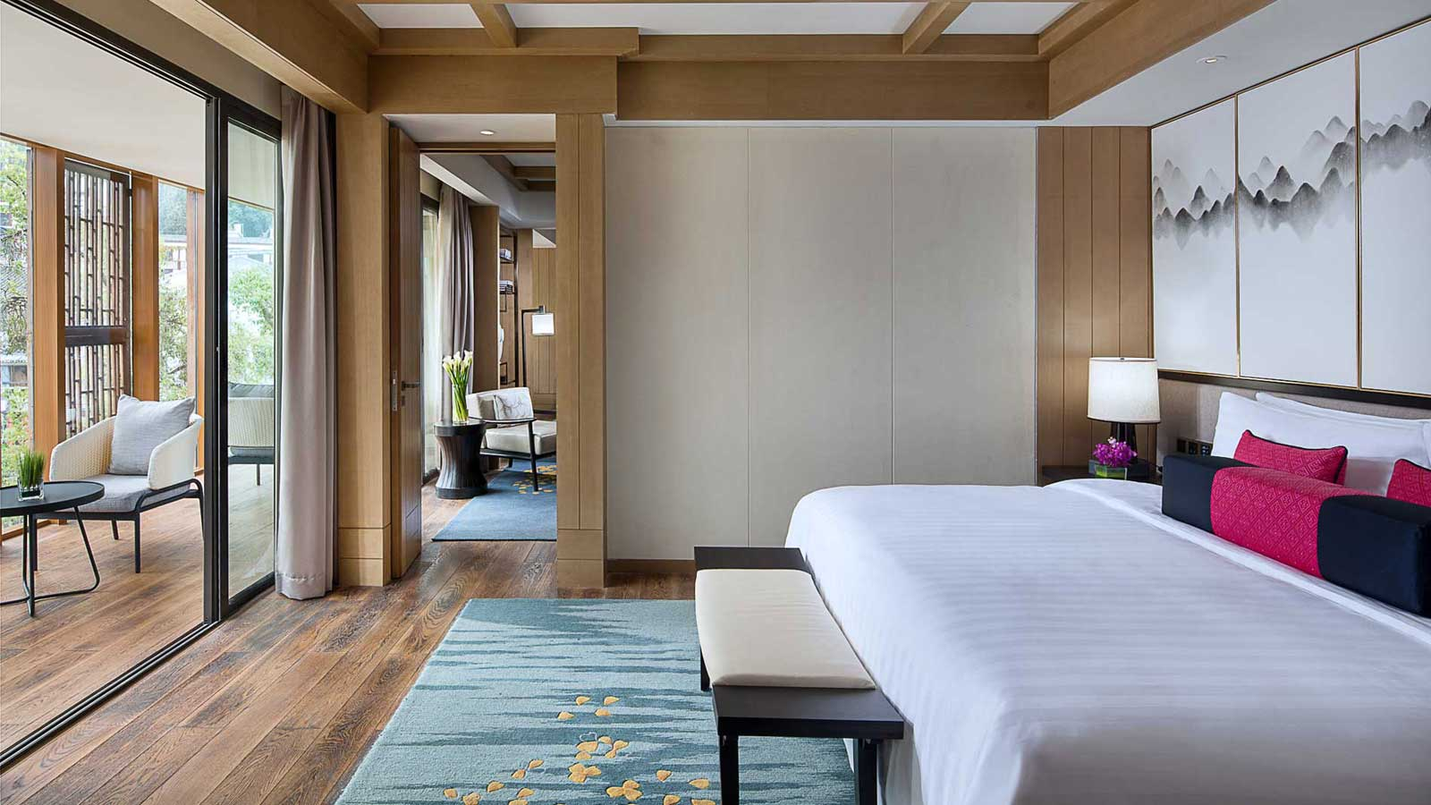 King-sized bed in Three Bedroom Suite