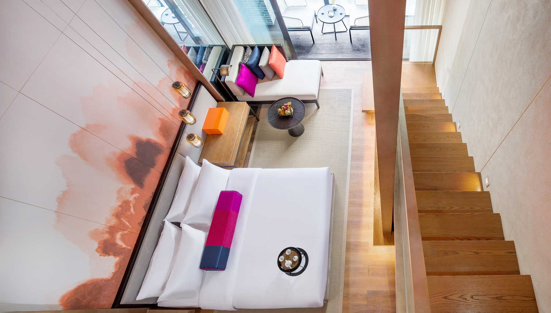 King-sized bed in Two Bedroom Duplex
